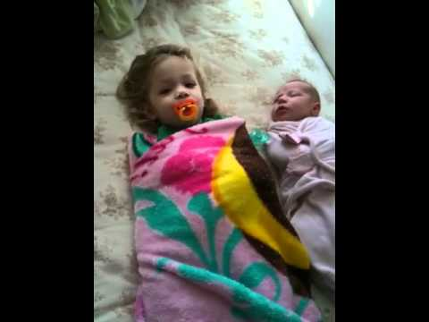 Swaddled sisters
