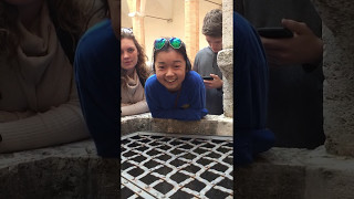 me singing into a well in italy