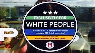 """""""Whites Only"""" Stickers Posted In Front Of Austin Businesses"""
