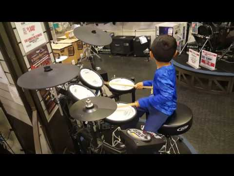 Playing drums at Sam Ash
