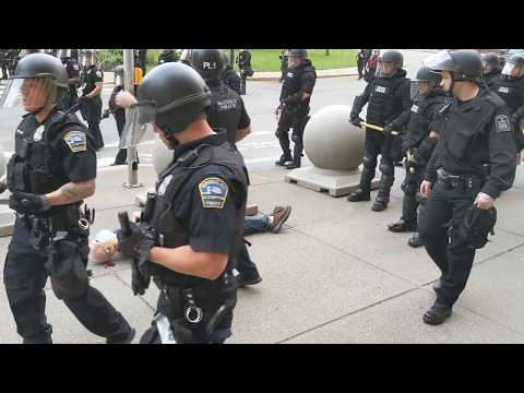 Two Buffalo police officers shove a man to the ground in front of City Hall (WARNING: GRAPHIC)