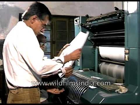 Indian men work at a printing press in olden days