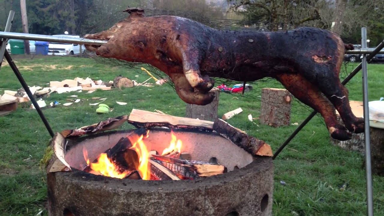 How To Roast A Pig, Roasting A Pig Over Fire :) - YouTube