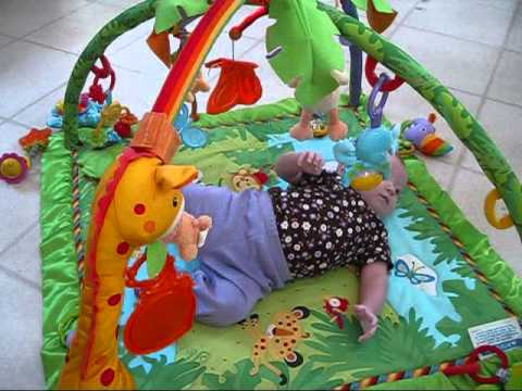 Haley using her Fisher-Price Rainforest Playmat