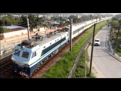 {ICTT} SS8 0148 hauling T100 Shanghai Through Train passing Kau Lung Hang