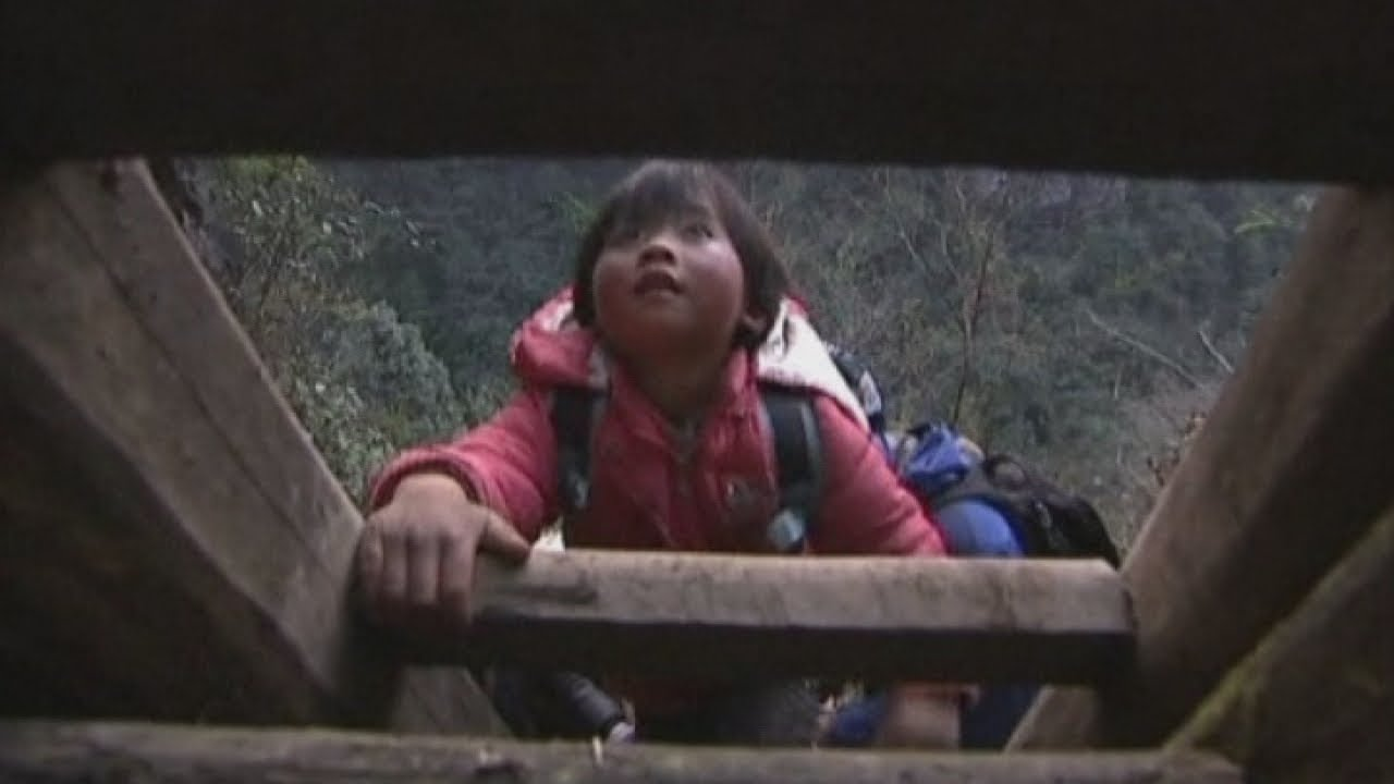 Chinese children climb ladders to get home from school