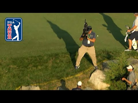 Cameraman dodges golf ball at Dell Technologies