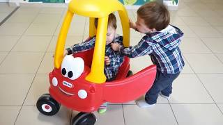 BABY AND CAR Funny Toddlers Fight for Car LITTLE TIKES ON PLAYGROUND