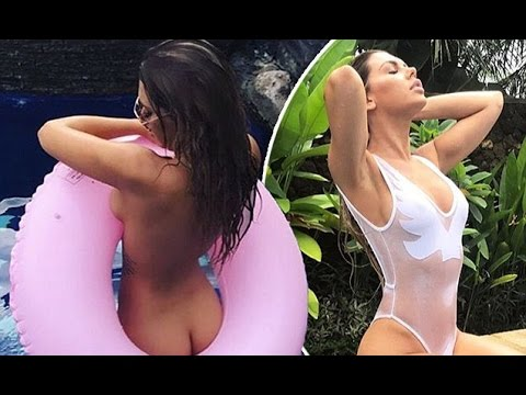 Delicious! Bachelor's Kirralee 'Kiki' Morris with inflatable doughnut during vacation in Bali with b