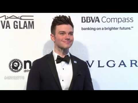 Chris Colfer on the white carpet at the 25th Annual Elton John AIDS Foundation