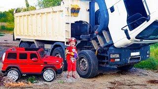 Big Truck is broken down Funny Fireman Ride on POWER WHEEL Fire truck to help his friend