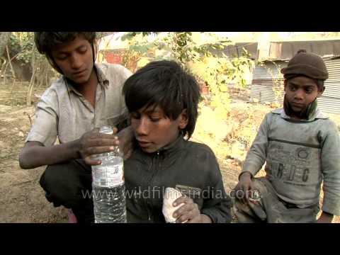 Teeanage rag pickers on Delhi streets