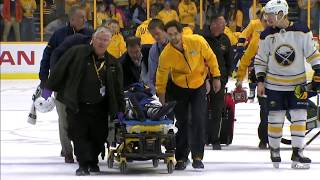 Antipin Stretchered off after hit from Hartnell into the boards