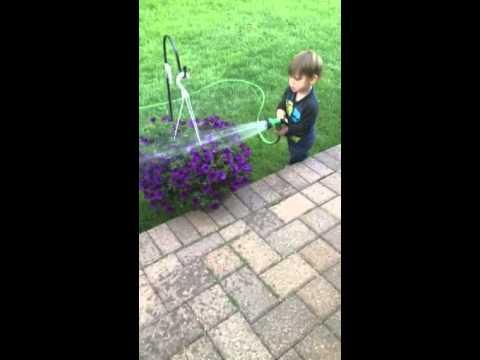 Drew waters the plants