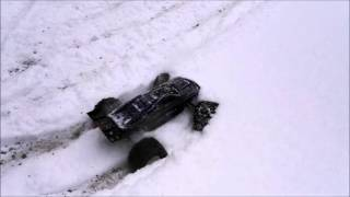 traxxas e revo brushless mm2 in deep snow with proline big joes and 6s lipo