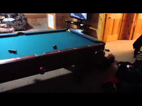 Brother And Friend Trying To Lift A Pool Table With Feet.