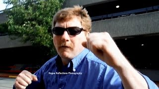 Crazy transit employee goes berzerk, assaulting armed photographer