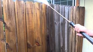 Power washing our fence.