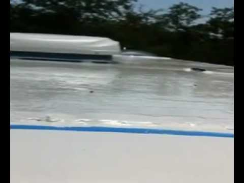 Application Of Liquid Roof On And Rv Epdm Coatings Llc