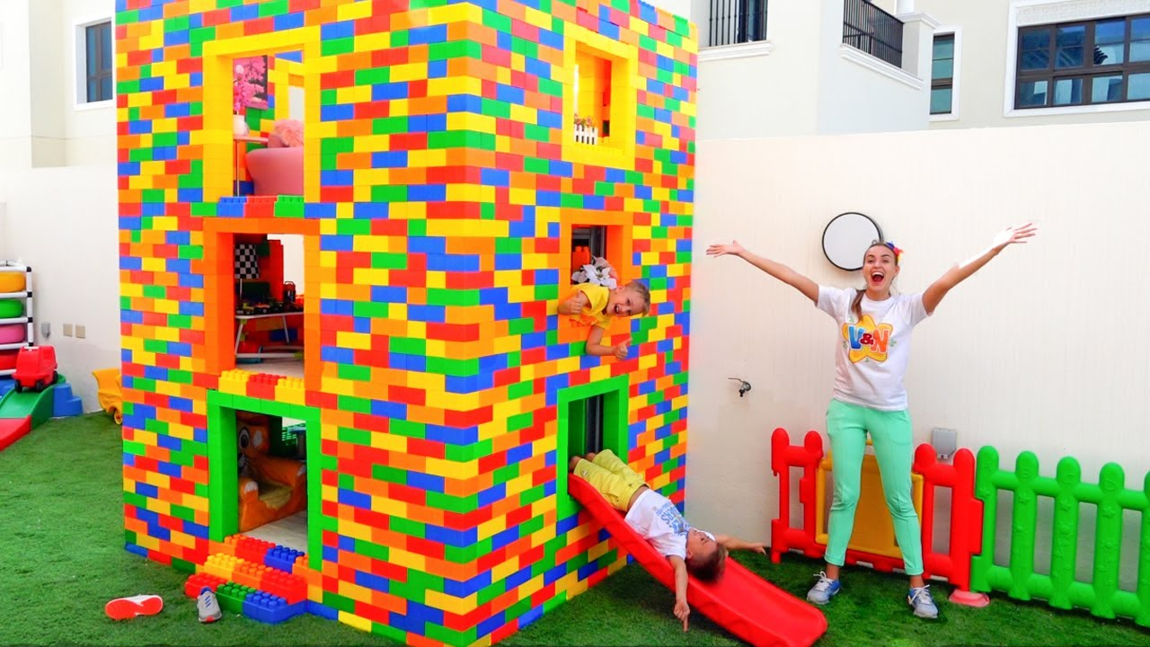 Vlad and Niki play with colored toy blocks and build Three Level House