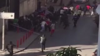 RAW Shots fired as refugees escape burning deportation center in Istanbul