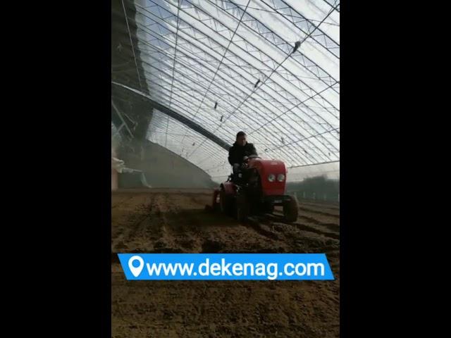 Mini garden tractor working in greenhouse #1