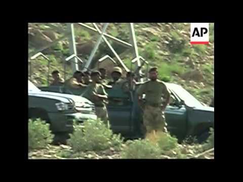 Simultaneous attacks on military convoy kill 18