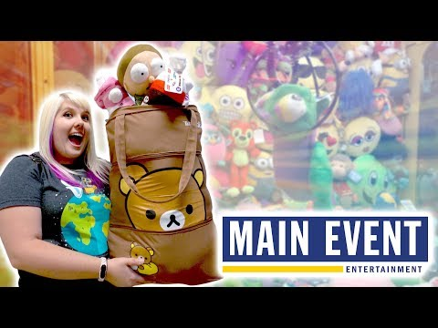 Cleaning out the claw machine at Main Event arcade in Texas!