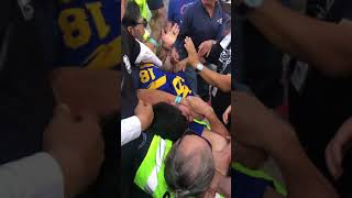 Rams fans go crazy and get choked by security guards and punched