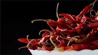 Rotating heap of dried red chilies (Indian Masala - Lal Mirch) in a bowl