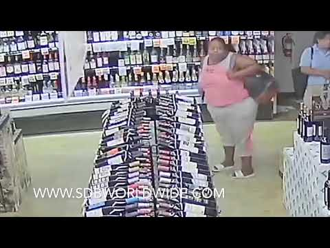 FAT LADY STEALING LIQUOR AT A STORE