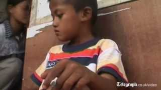 Eight-year-old boy smokes two packs of cigarettes a day