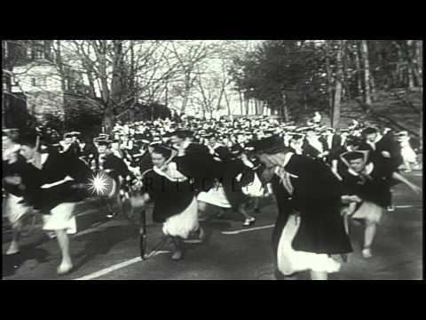 College girls participate in the hoop-rolling contest in Wellesley college in Mas...HD Stock Footage