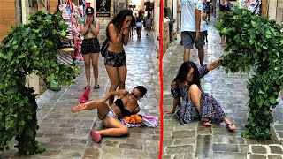 Two Girls FELL On Ground!! AWESOME Reactions!! Bushman Prank