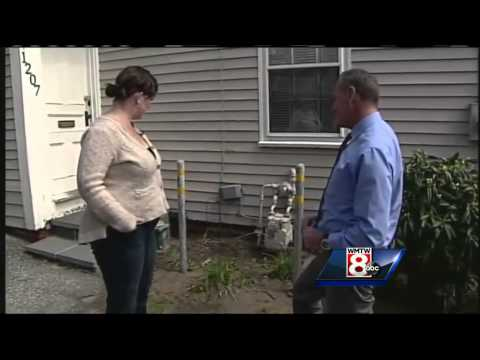 Woman upset by poles placed around gas meter