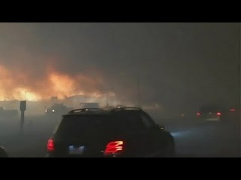 [INSIDE] Canada, Alberta. Fort McMurray fire. Mass evacuating Fort McMurray southbound on Highway 63