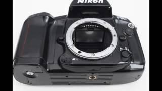 Nikon F90 35mm autofocus SLR camera + AF Nikkor 35-70mm f/3.3-4.5 + strap
