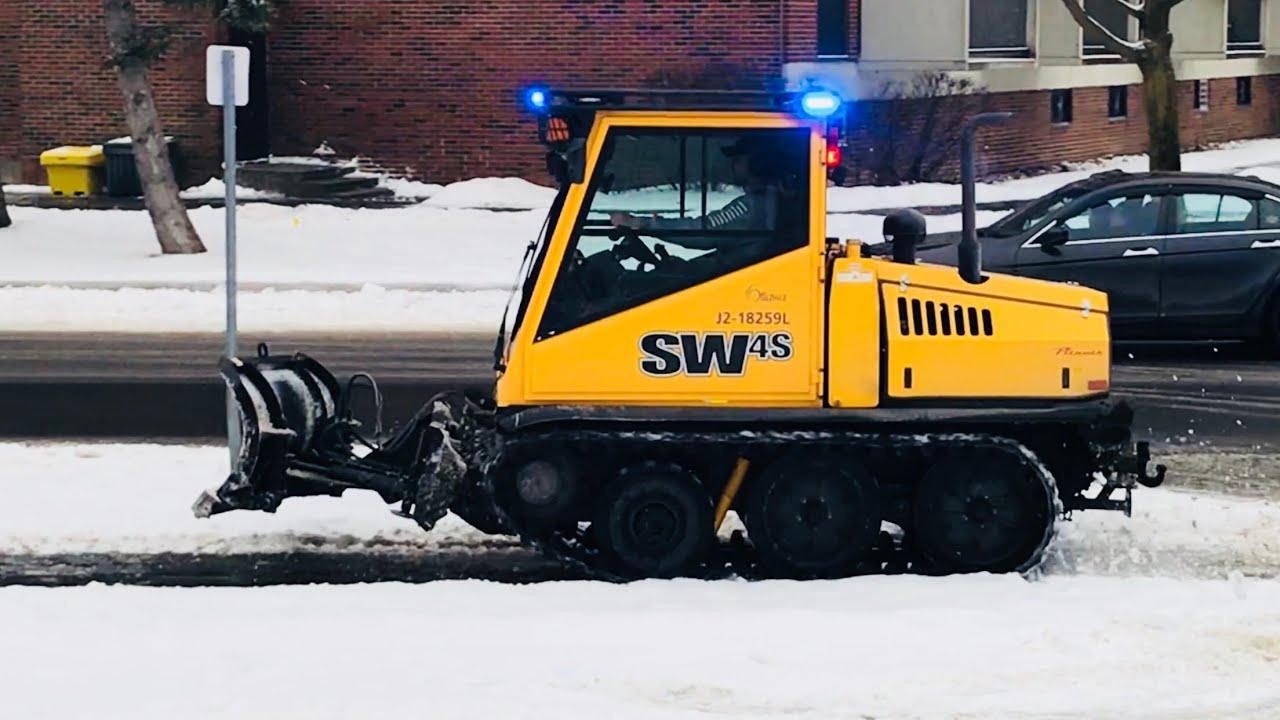 Snow Removal Bombardier SW4s Plowing Snow