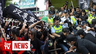 Scuffles in Hong Kong as China's birthday celebrations begin