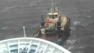 Storm-stricken ferry in danger of collision gets rescued by tug boats