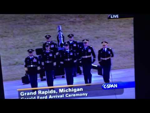 President Ford greeted by the U of M marching band