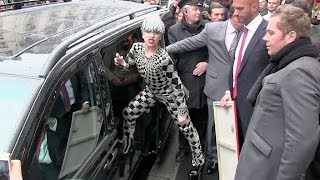 Lady Gaga greets her fans and give them flowers in Paris