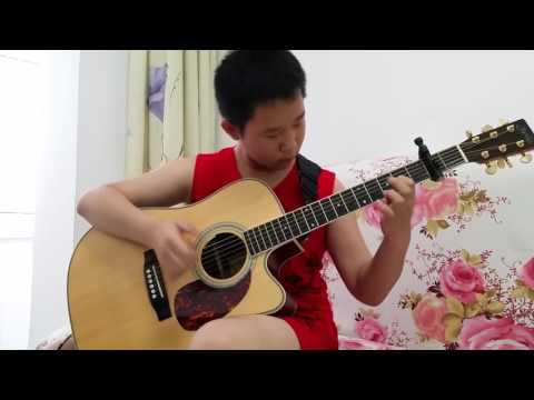 12 Year-Old Self-taught Chinese Guitar Prodigy Plays AC/DC's Thunderstruck