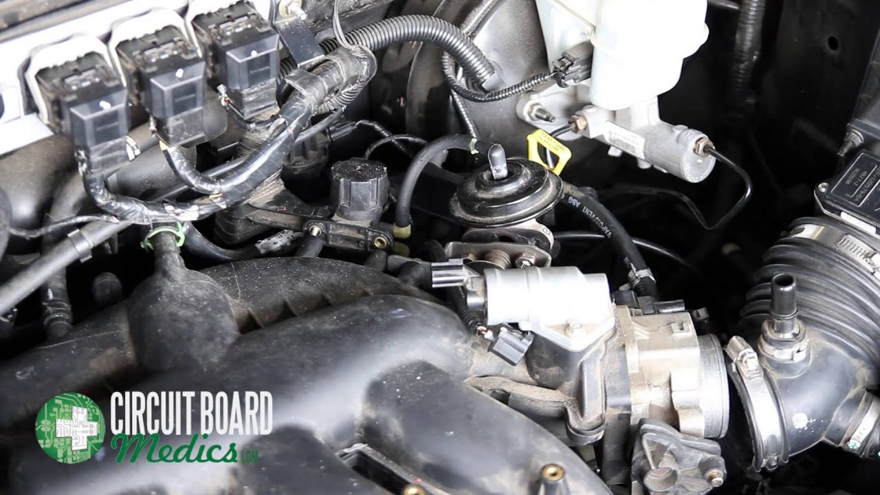 how to remove and replace ignition coils 2005 2006 ford escape p0351 p0352 p0353 p0354 p0355 p0356 circuit board medics [ 1280 x 720 Pixel ]