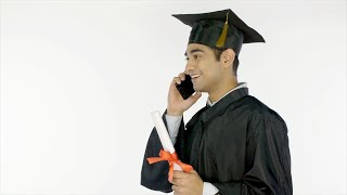 Happy Indian student makes a call to his family after receiving a graduation degree