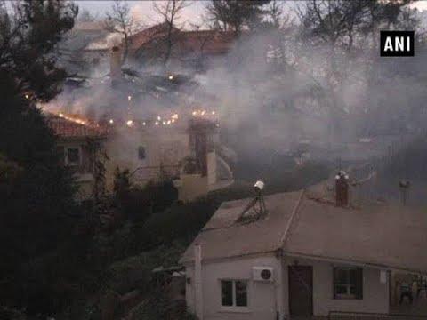 Greece seeks EU help as wildfires rage - ANI News