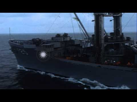 The forward battery of the USS Providence (CLG-6) fires at the shore targets off ...HD Stock Footage