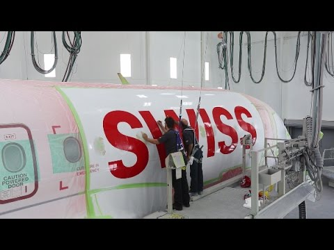 C Series aircraft: our artist at work dressing the CS100 in the SWISS livery