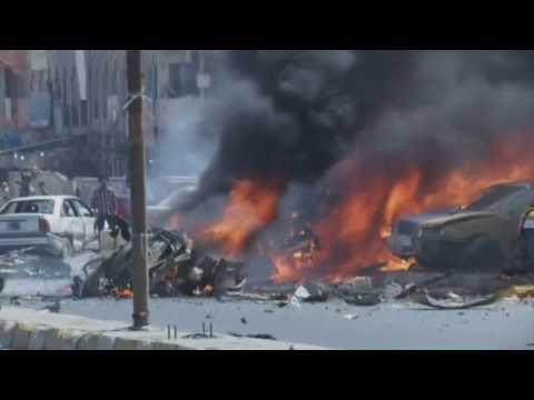 AP- Baghdad blasts kill dozens