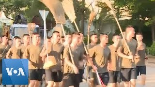 Chinese Army Arrives to Hong Kong to Clean-up After Protests